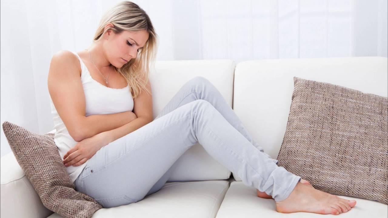 Вздутие внизу живота у женщин: причины и лечение